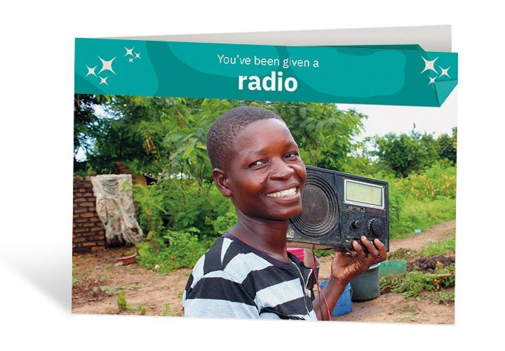 Grace with her radio at home in Malawi. She uses it to keep up to date with the world – and entertain her friends and family too! Photo: Jason Kennedy / Concern Worldwide
