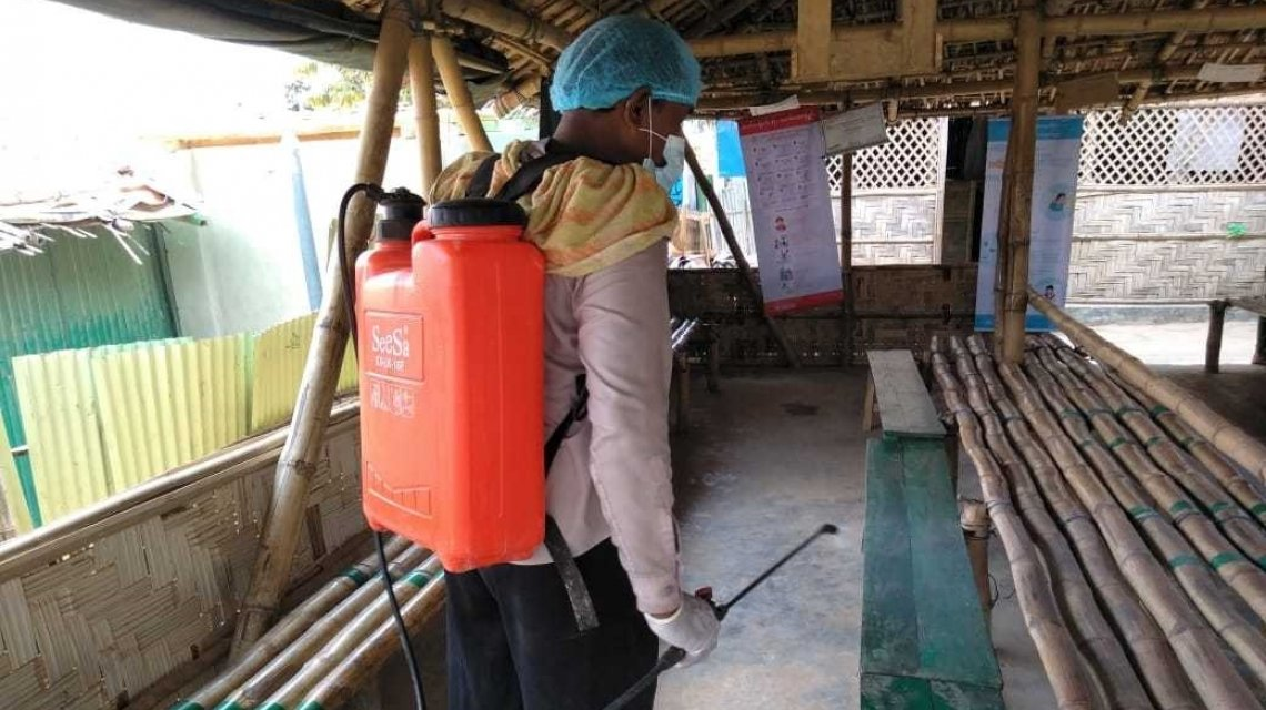 Volunteer disinfecting a nutrition centre in a Refugee Camp in Cox's Bazar, Bangladesh.
