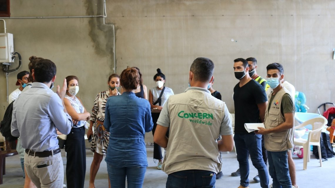 Volunteering groups are meeting each other in the warehouse to discuss and plan their response to the Beirut blast. Photo: Jade van Huisseling