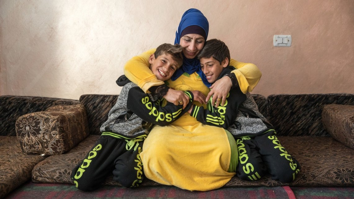 Fatima, here with her children, fled her home in Syria. Photo: Act for Peace