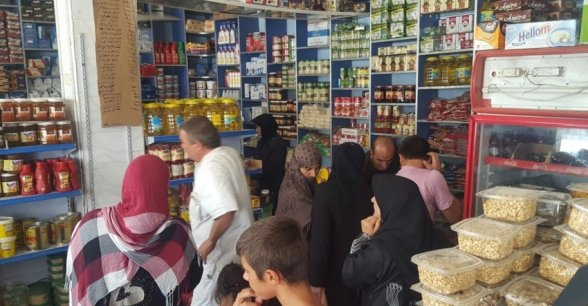 Inside a designated shop where people can redeem their pre-paid food vouchers from Concern. Photo: Concern Worldwide.
