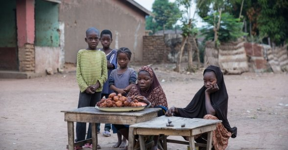 Children set up a stall to sell their wares to early morning passers-by in the town of Kouango, Central African Republic. This is one of the poorest areas of one of the poorest countries in the world. Photo: Kieran McConville / Concern Worldwide.