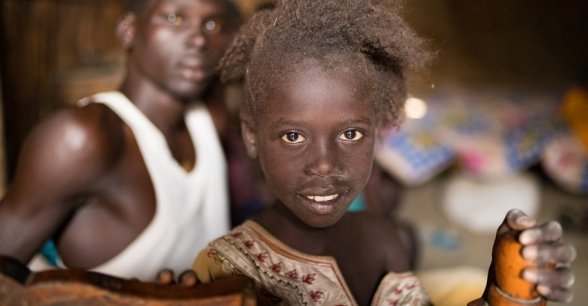 Tieni Gal (8) with her cousin Malech Jal (16) inside their home in Bentiu's PoC. Photo: Steve De Neef/Concern Worldwide.