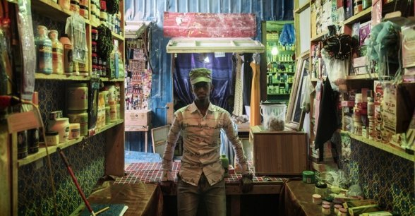 *Abshir's shop in a market near Mogadishu. It operates through the youth entrepreneurship group's shop program, the owner receives training and support from Concern. Photo: Marco Gualazzini/ Concern Worldwide.