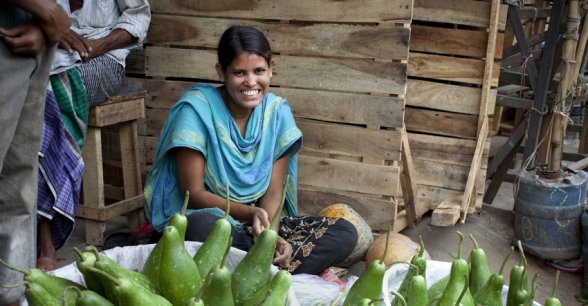 Moni selling vegetables at Karwan Bazar market in Bangladesh. The business was started after receiving a grant from Concern. Photo: Abbie Trayler-Smith/Panos Pictures for Concern Worldwide