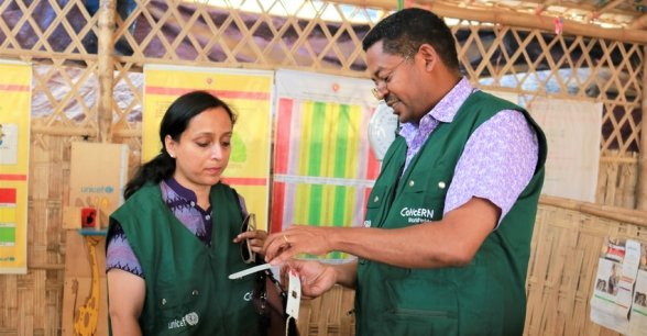 Nutrition Advisor Dawit Hagos showing the nutrition measurement procedure to System Director Hasina Rahman. Bangladesh. Photo; Concern Worldwide