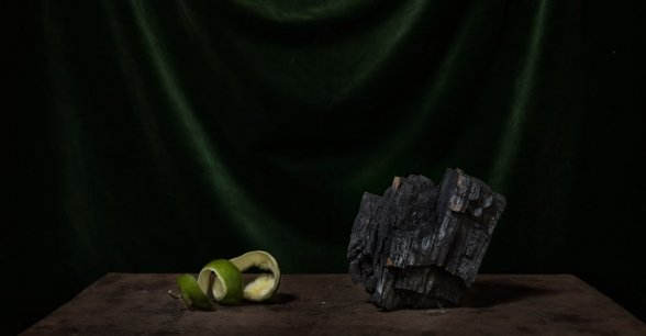 Pictured is some orange peel and a charcoal lump. Estella is part of Gbadengue village seed group, which receives seeds, tools and advice from Concern. Photo: Chris de Bode