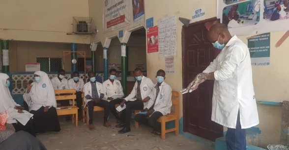 Staff receive training in hand washing, Somalia.