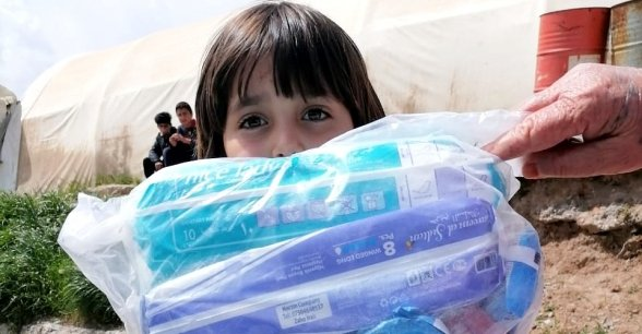 Distribution of COVID-19 prevention Hygiene Kits at IDPs camp Dohuk Kurdistan Iraq Photo: OCHA.