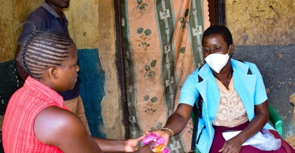 Mary Ambweni, Health Surveillance Assistant, at a heath centre in Lilongwe distributing soap to beneficiaries.