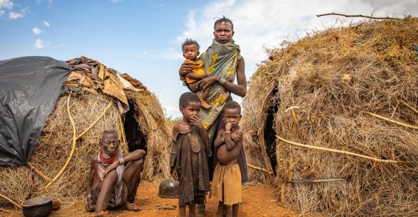 Ng'ikario Ekiru feeds her family with wild desert fruit and roasted animal hides as they experience the second drought in three years. Photo: Gavin Douglas