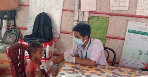"""""""Seeing news updates definitely worries me, but I am a humanitarian worker, I cannot turn my back from this. It is my regular duty to work for the Rohingya community and help to prevent their children's suffering from malnutrition."""" – Atiqul Islam, Nurse for Concern Worldwide. Photo: Poresh Chandra Ray"""