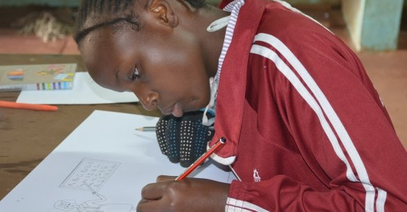 Brighton from Kenya draws what she wants to be when she grows up: a teacher.
