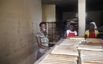 Christela Louis inside the bakery (supported by Concern) where she has worked since May. Christela is confident that through working here, she will be able to grow her business and start saving money. Photo: Kristin Myers