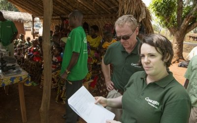 Former Concern Chairman, Tom Shipsey, and Regional Director, Reka Sztop, at a mobile health clinic run by Concern Worldwide at Bougoin, Central African Republic. This is one of fourteen such mobile clinics, which is designed to facilitate people who are far removed from fixed health facilities. Photo: Kieran McConville / Concern Worldwide.