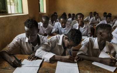 Boys attend class at a school near Mogadishu. It was constructed and is run by Concern Worldwide. The school has some 1250 students. The school is totally free, Concern provide students with uniforms, books and education material. Photo: Marco Gualazzini / Concern Worldwide