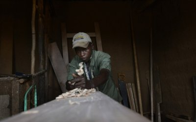 Married father-of-two Daniel Nsabiyaremye (28) started up a bike repair and carpentry business upon completing Concern's graduation programme in Burundi. Photo: Chris de Bode/Concern Worldwide