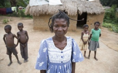 Kazadi wa Mwamba Charlotte, 40, a widow and mother of 7, pictured with four of them at her house in Manono, DRC. She is participating in Concern's graduation program. Photo: Kieran McConville / Concern Worldwide