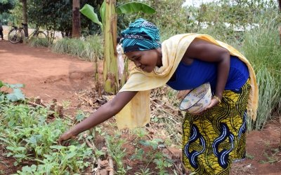 Marie shows other women how to prepare more nutritious meals and set up a kitchen garden – in order to tackle childhood malnutrition. Photo: Darren Vaughan