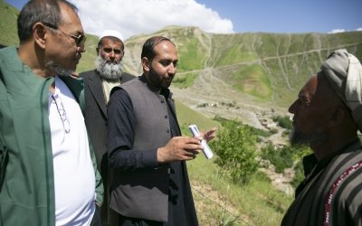 Gerard Ganaba and Zimarai Hashimzai of Concern meet with members of a watershed management committee in Afghanistan. Photo: Kieran McConville / Concern Worldwide