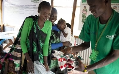 Concern staff give out PlumpyNut to the parents of malnourished babies and children, South Sudan. Photo: Abbie Trayler-Smith