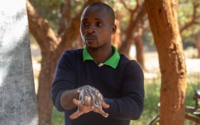 Samson Ngoma, demonstrating proper handwashing using soap, Malawi Photo: Henry Mhango