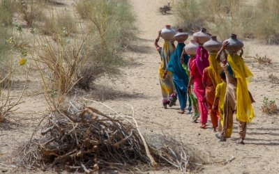 Sharjeel Arif/Black Box Sounds 2017. Community women carrying water in mud pots from the communal well.Umerkot district, Sindh province, Pakistan.