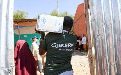 Concern Worldwide staff unloading trucks ahead of food distribution in Filtu, Somali Region, Ethiopia. Photo: Jennifer Nolan / Concern Worldwide