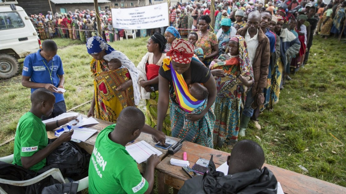A Concern distribution of tarpaulins to displaced families in Katale, Masisi, DRC.