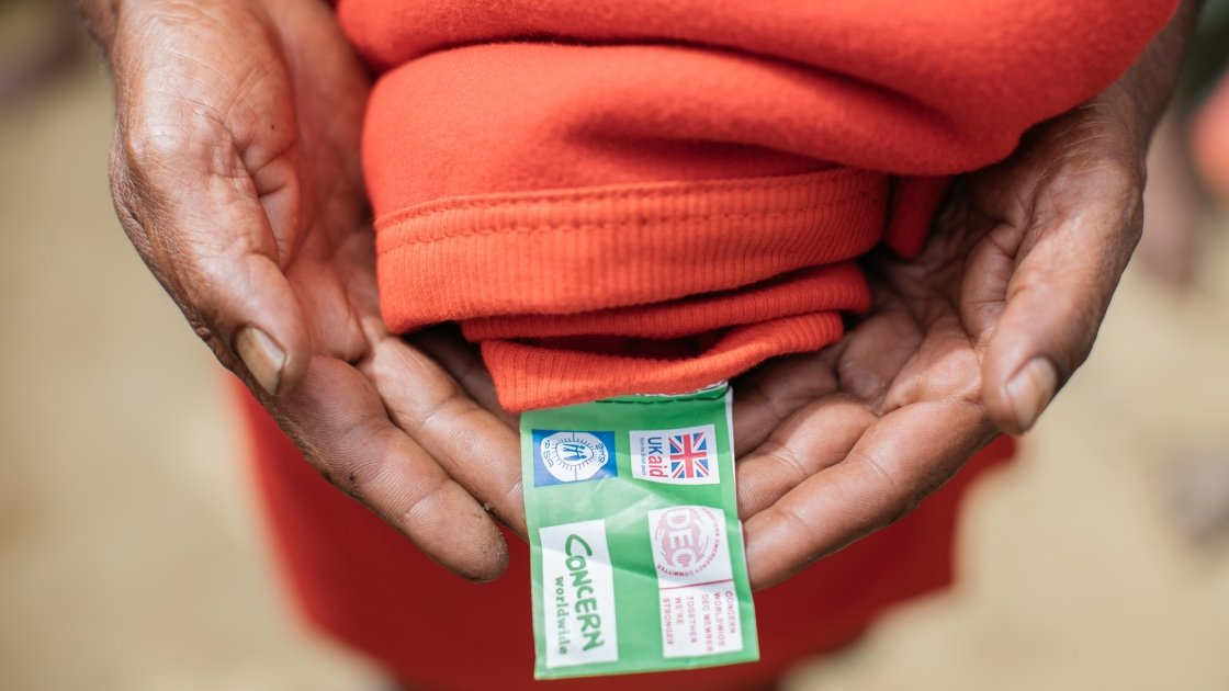 A blanket with the UK Aid, DEC and Concern logos sewn into the label, Mainarghona camp, Cox's Bazar. Photo: Paddy Dowling/DEC/Concern Worldwide