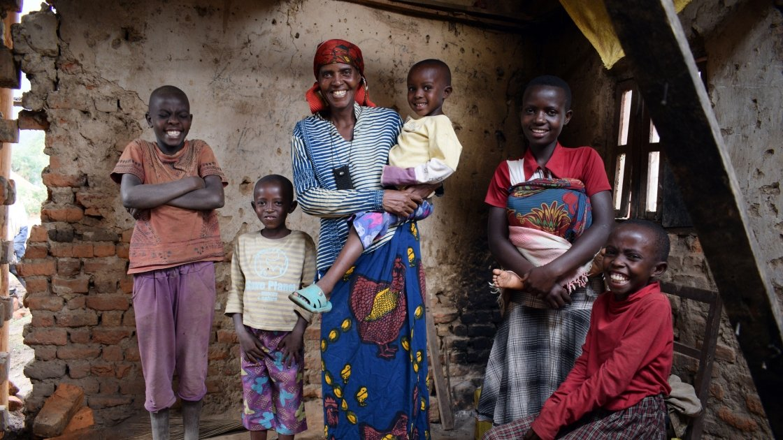 Violette Bukeyeneza was selected to be part of Concern's Graduation programme. She can be seen here with her children. Renovations on her house have now begun, and she has also started a small business selling banana juice twice a week – and has earned enough to buy a goat. She now has plans to convert her front room into a small grocery shop. Burundi. Photo: Darren Vaughan/Concern