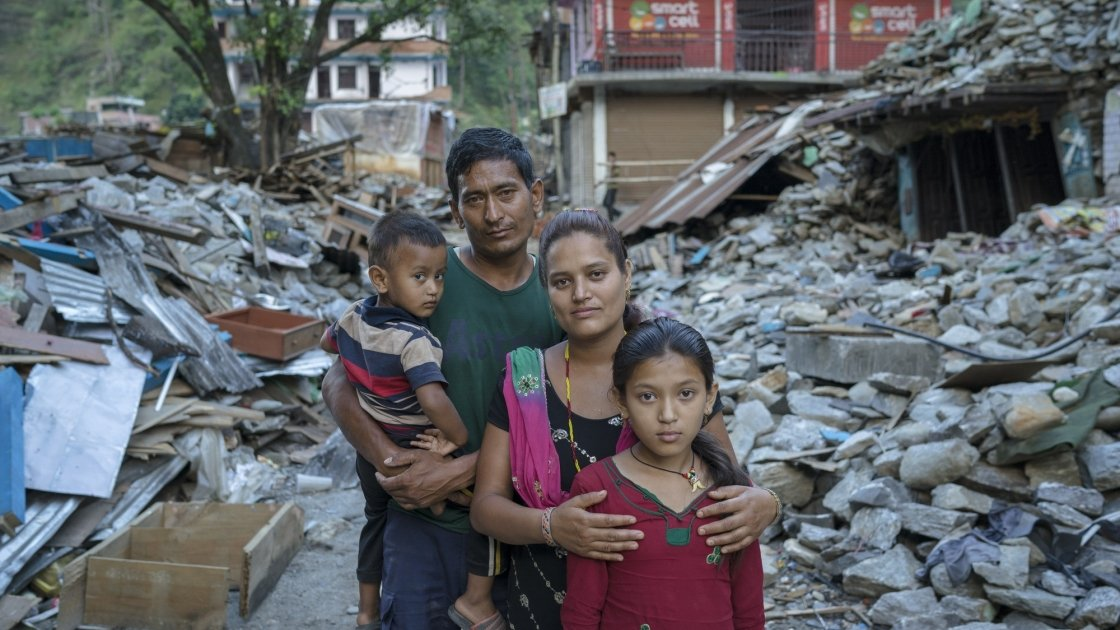 Niv and Shanti Shrestha and their children stand amongst the devastation caused by the earthquake in Dolakha district, Nepal. Photographer: Brian Sokol, 2015, Nepal