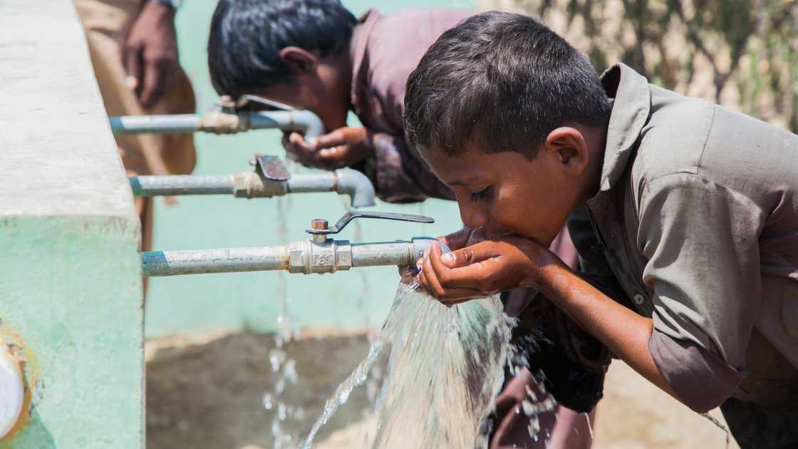 Children from Satla Bheel village enjoy drinking water from the water plant system installed by Concern. Photo: Black Box Sounds/ Concern Worldwide.