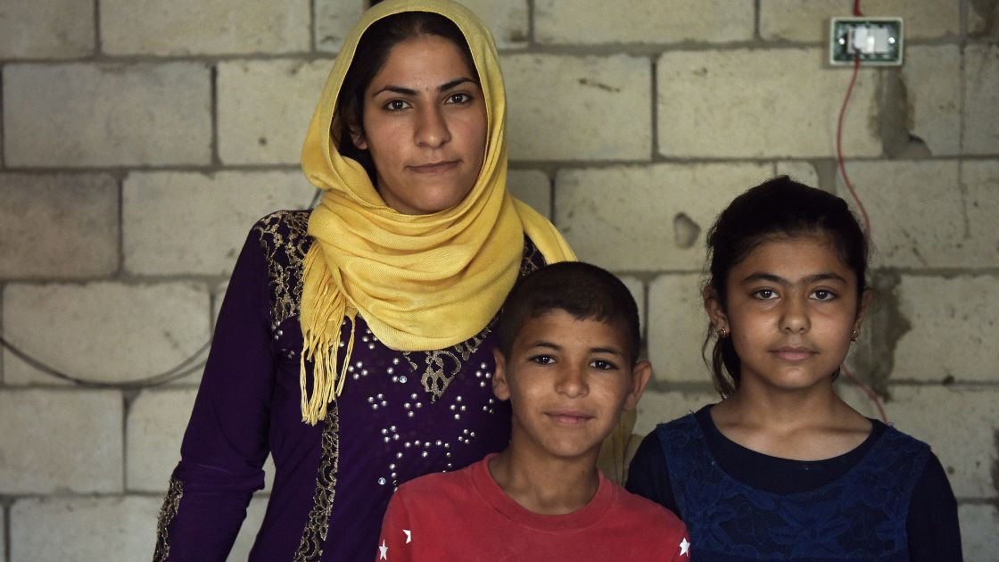 *Kafya (30) , with her children *Azzam, 11, and *Lara, 10, at the home which they live in and which is being refurbished by Concern, in Northern Lebanon. Photo: Mary Turner