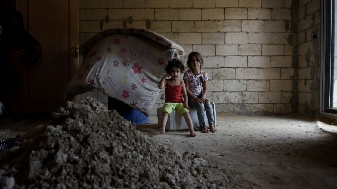 Syrian refugees *Alya, aged 5, and her cousin *Sultan, aged 4, are pictured in the home they share with their family and cousins after being moved by Concern as they were in danger. Photo: Mary Turner