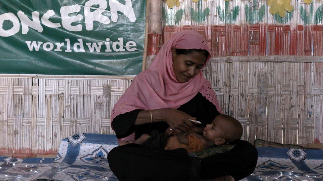 Woman feeding her child.