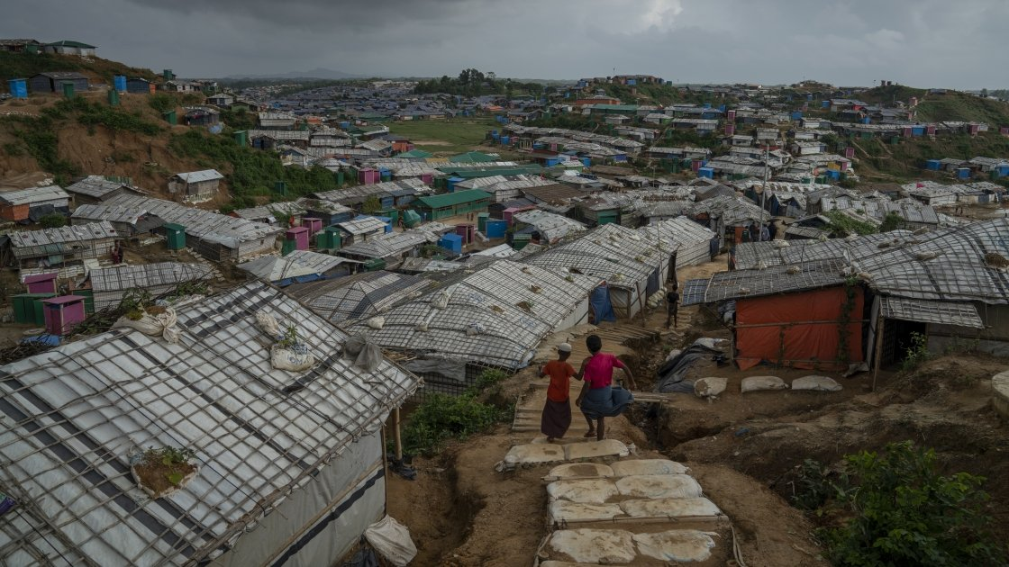 Two people look over Rohingya refugee camp