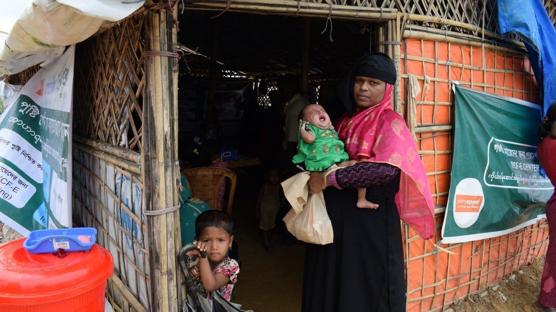 Arshia holds baby Aklima in Cox's Bazar. Photo: Darren Vaughan / Concern Worldwide