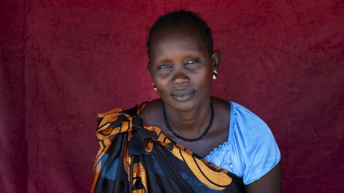 Dukan* lives with her family in a POC in Juba. Dukan* is cooking Walwal. Photo: Abbie Trayler-Smith