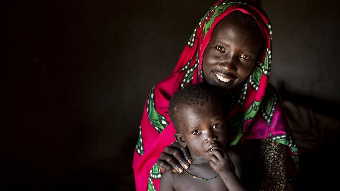 Nyarok* with her youngest child, two and a half year old Axlam*. Photo: Abbie Traylor-Smith/ Concern Worldwide