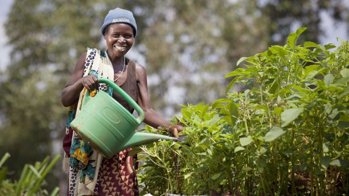 Euphemia Inina waters her home garden in Mabayi, Cibitoke. Photo: Abbie Trayler-Smith