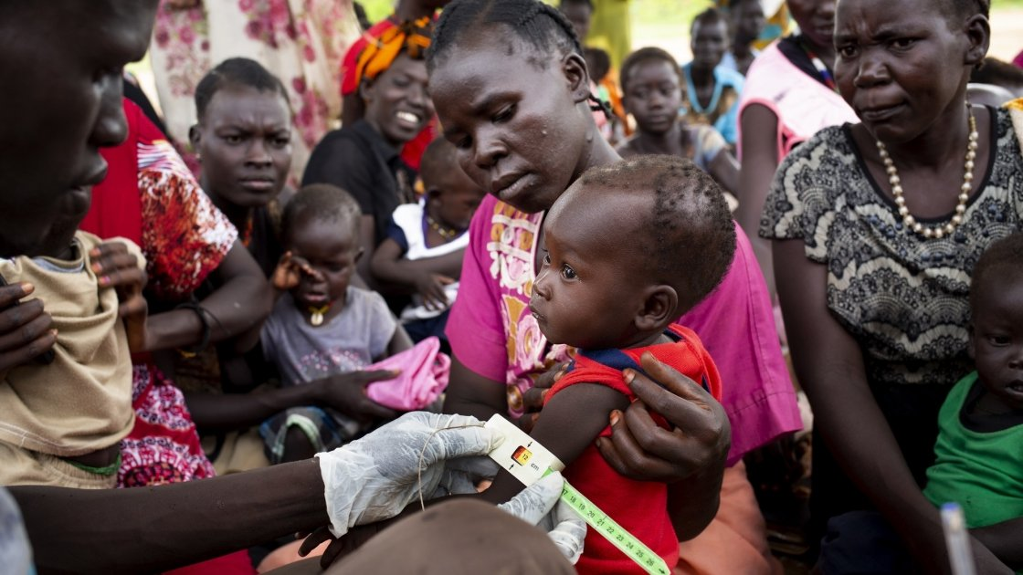People gather for a Concern Worldwide nutrition clinic, South Sudan. Photo: Abbie Trayler-Smith