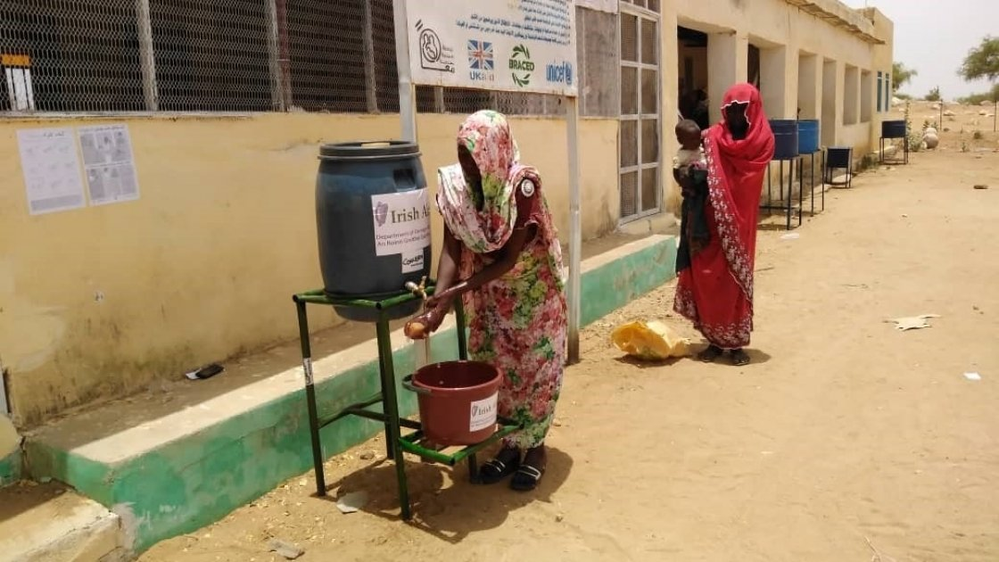 To help reduce the spread of Covid-19 people wash hands before entering Concern-supported Nutrition Facility, Sudan.