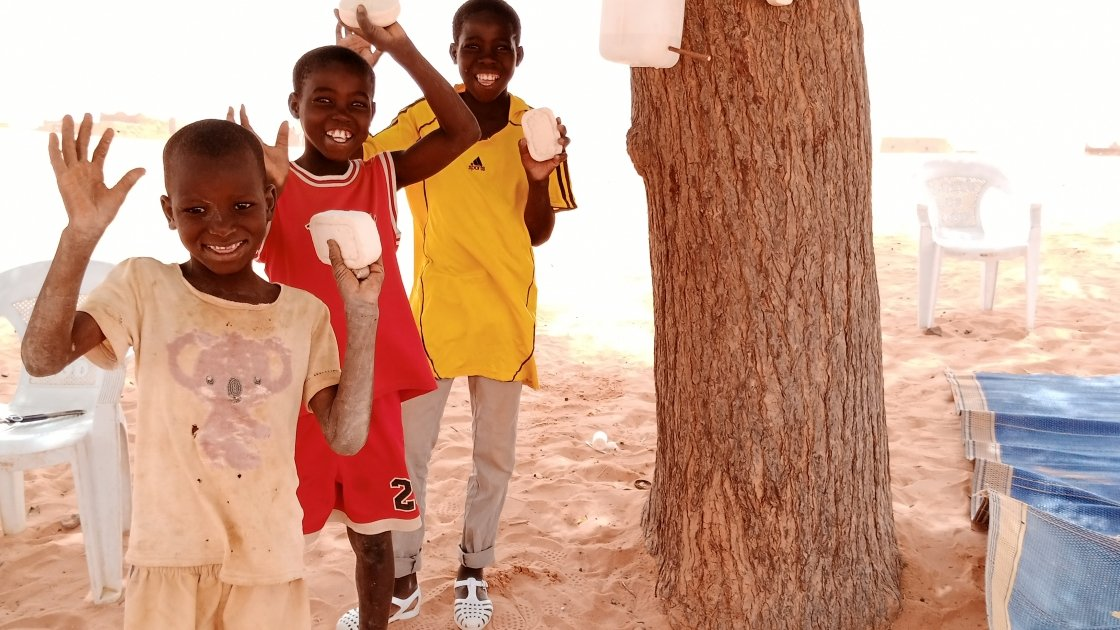 Three brothers attend a Covid-19 awareness session in Tahoua, Niger.
