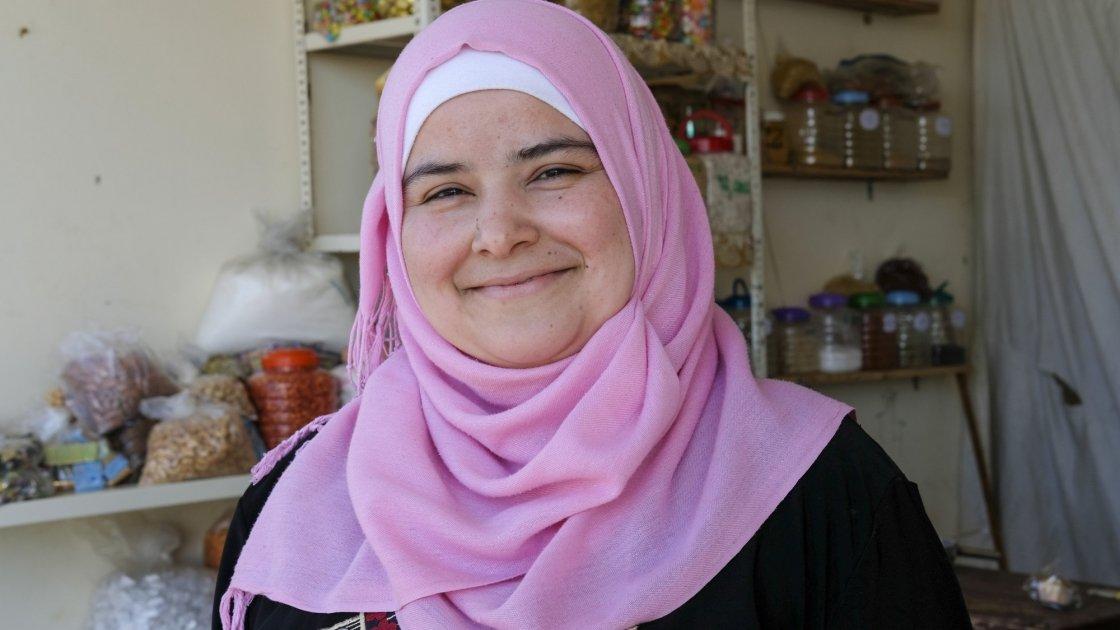 Bushra runs a small grocery shop near the tented settlement where she lives. Photo: Darren Vaughan