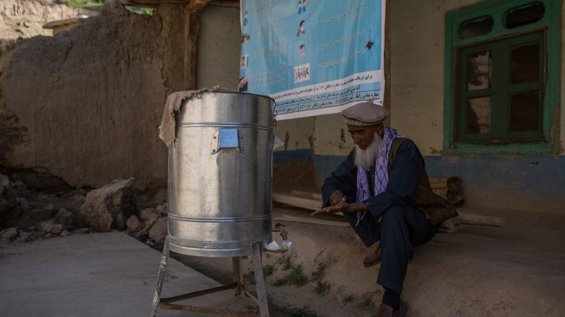 Village elder Edris*, 60, washes his hands as preventative measure to the spread of Covid-19. Photo: Stefanie Glinski