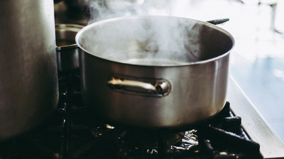 A silver pan on a hob