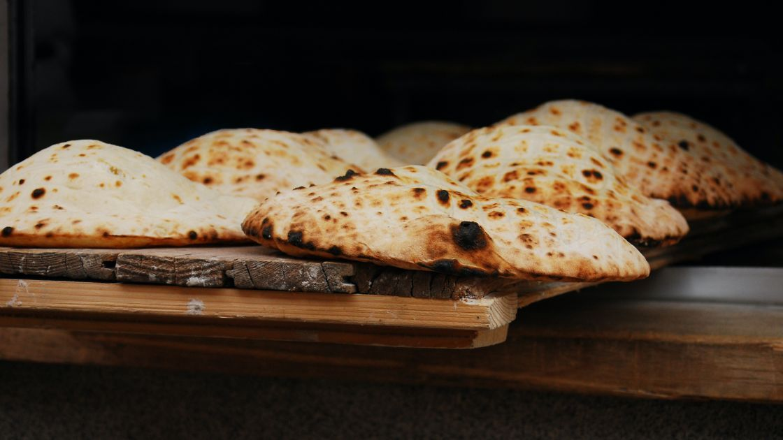 Flatbreads on a wooden chopping board