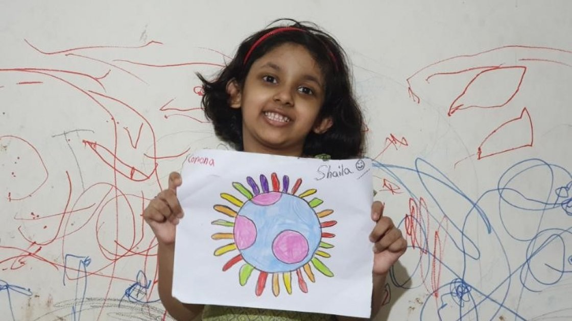 7-year-old Shalia with her artwork, Bangladesh.
