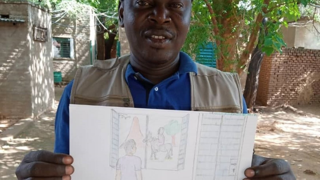 Kouguer, a water quality technician for our WASH studies and projects in Chad, with his drawing.